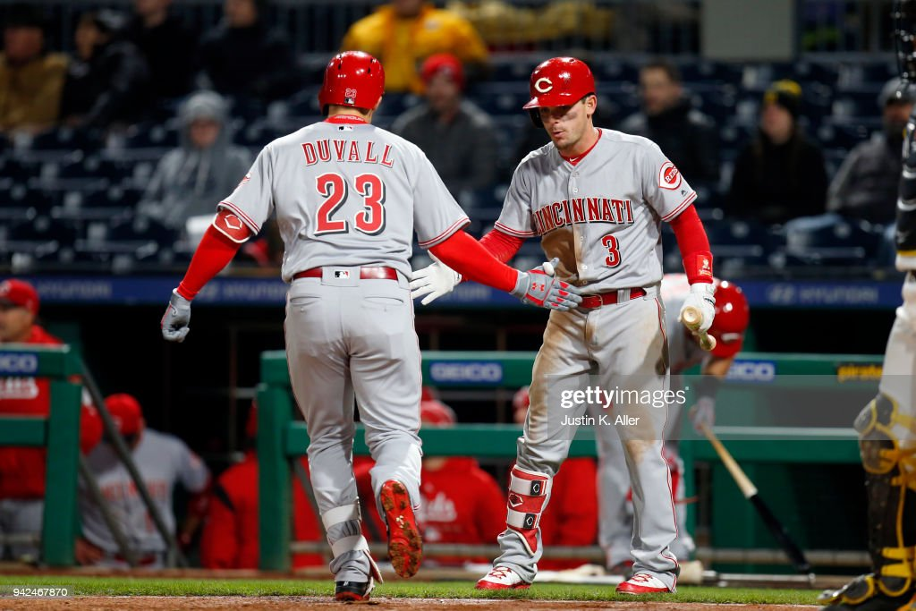 Adam Duvall #23 of the Cincinnati Reds celebrates with Scooter Gennett #3 after hitting a solo home run in the eighth inning against the Pittsburgh Pirates at PNC Park on April 5, 2018 in Pittsburgh, Pennsylvania.