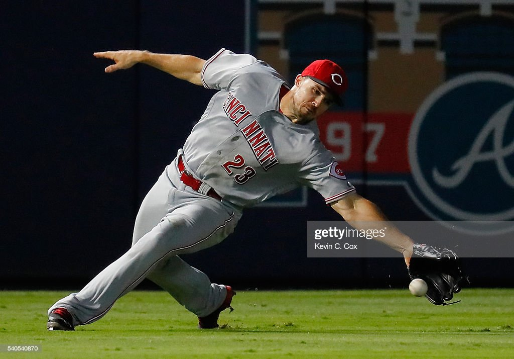 Adam Duvall #23 of the Cincinnati Reds fails to field this double hit by Mallex Smith #17 of the Atlanta Braves in the 10th inning at Turner Field on June 15, 2016 in Atlanta, Georgia.