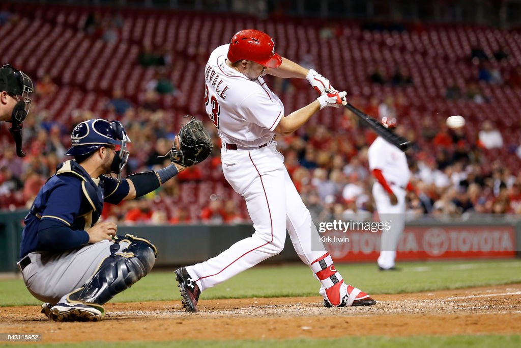 Adam Duvall #23 of the Cincinnati Reds hits a sacrifice fly and drives in Patrick Kivlehan #3 of the Cincinnati Reds for a run during the seventh inning of the game against the Milwaukee Brewers at Great American Ball Park on September 5, 2017 in Cincinnati, Ohio. Cincinnati defeated Milwuakee 9-3.