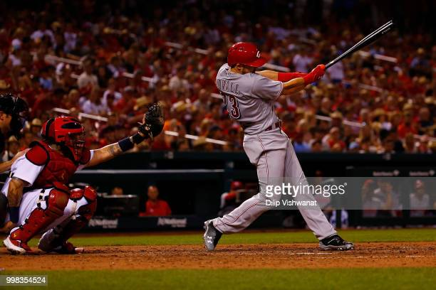 Adam Duvall of the Cincinnati Reds hits an RBI double against the St Louis Cardinals in the seventh inning at Busch Stadium on July 13 2018 in St...