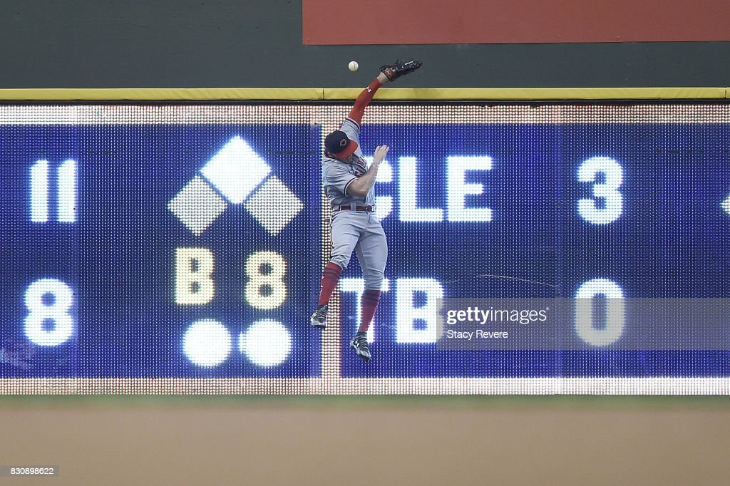 Adam Duvall #23 of the Cincinnati Reds is unable to catch a home run hit by Eric Thames #7 of the Milwaukee Brewers during the sixth inning at Miller Park on August 12, 2017 in Milwaukee, Wisconsin.