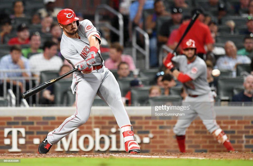 Adam Duvall #23 of the Cincinnati Reds knocks in a run with a sixth inning single against the Atlanta Braves at SunTrust Park on June 26, 2018 in Atlanta, Georgia.