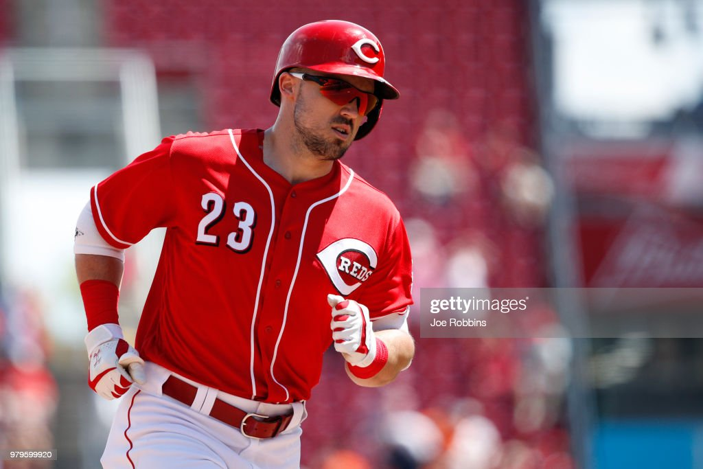 Adam Duvall #23 of the Cincinnati Reds rounds the bases after hitting a solo home run in the eighth inning against the Detroit Tigers at Great American Ball Park on June 20, 2018 in Cincinnati, Ohio. The Reds won 5-3.