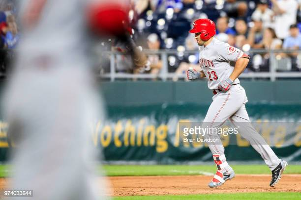 Adam Duvall of the Cincinnati Reds runs the bases after hitting a grand slam home run in the ninth inning at Kauffman Stadium on June 13 2018 in...