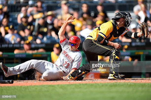Adam Duvall of the Cincinnati Reds scores in front of Chris Stewart of the Pittsburgh Pirates during the ninth inning on May 1 2016 at PNC Park in...