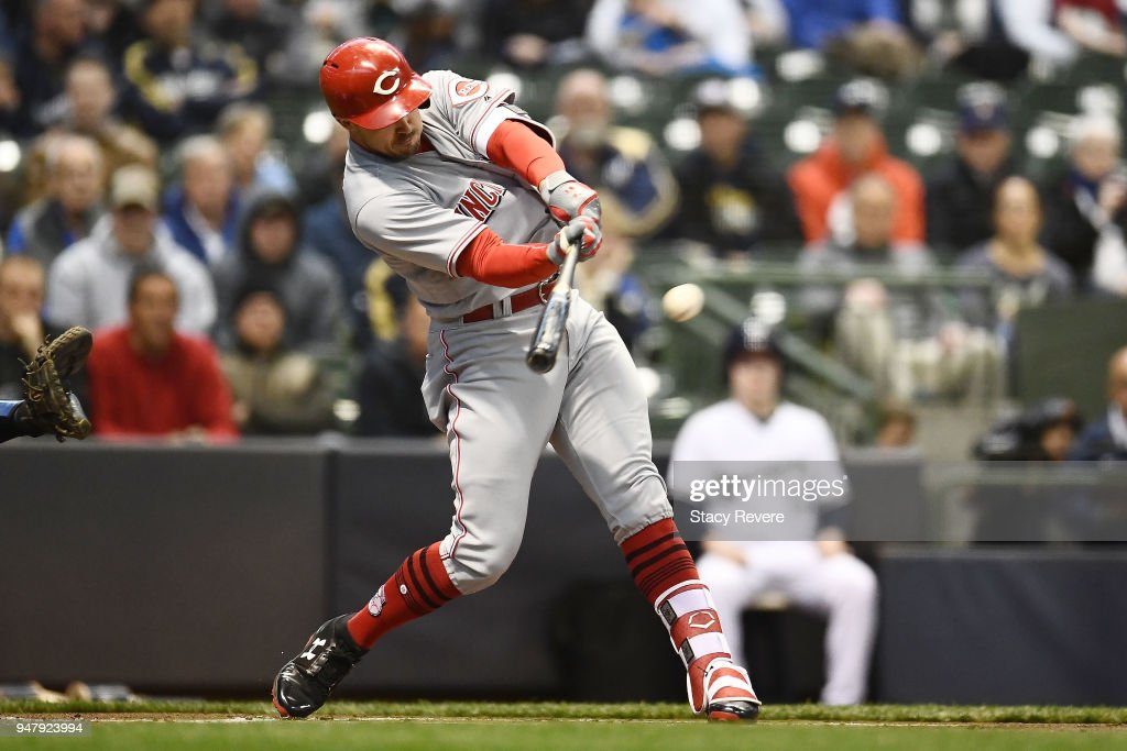 Adam Duvall #23 of the Cincinnati Reds swings at a pitch during the first inning against the Milwaukee Brewers at Miller Park on April 17, 2018 in Milwaukee, Wisconsin.
