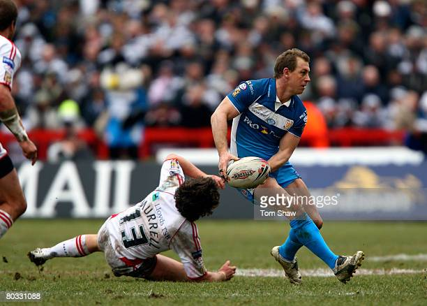 Adam Dykes of Hull FC avoids a tackle from Scott Murrell of Rovers during the Engage Super League match between Hull Kingston Rovers and Hull FC at...