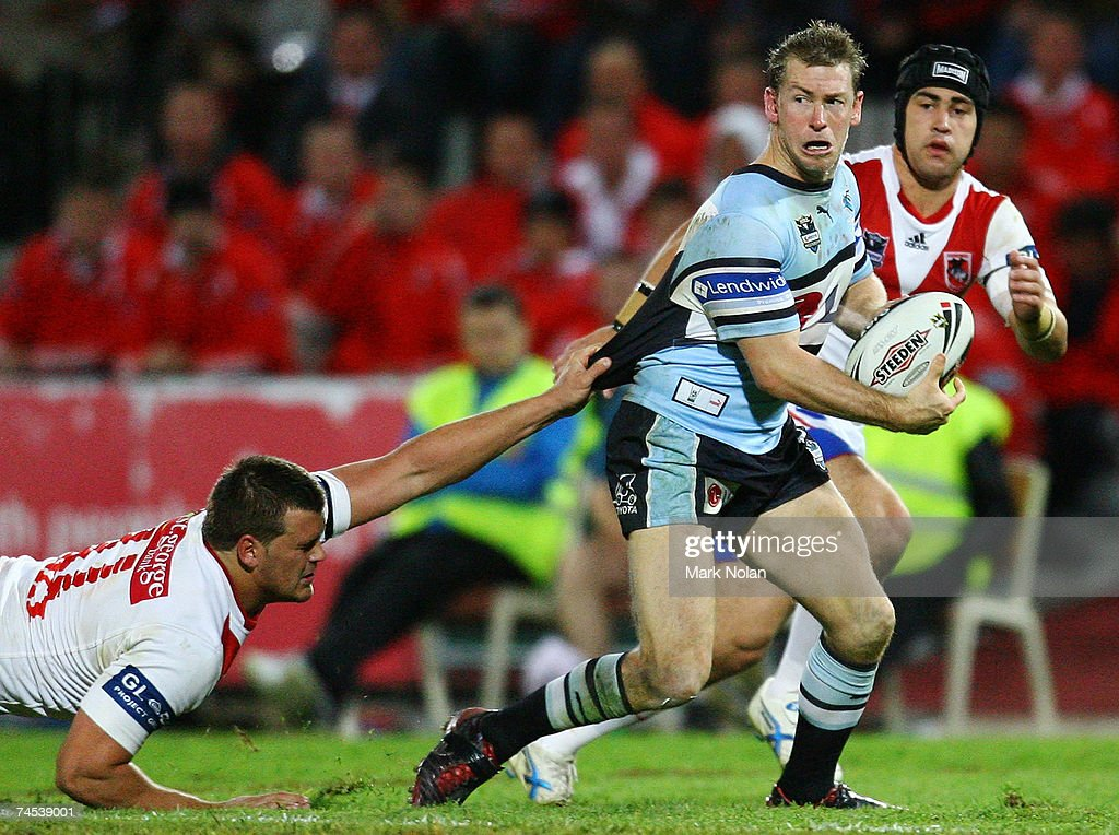 Adam Dykes of the Sharks makes a line break during the round 13 NRL match between the St George Illawarra Dragons and the Cronulla Sharks at OKI Jubilee Stadium June 11, 2007 in Sydney, Australia.