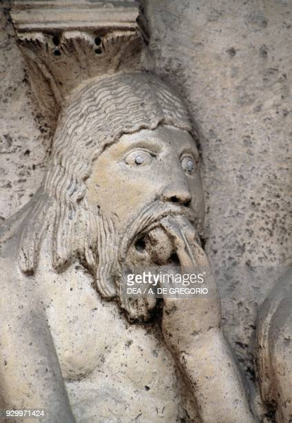 Adam eating the apple detail from Stories of Genesis by Wiligelmus marble basrelief facade of the Metropolitan Cathedral of Saint Mary of the...