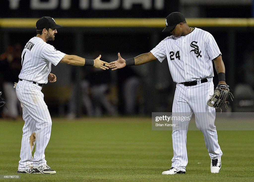 Adam Eaton #1 (L) and Dayan Viciedo #24 of the Chicago White Sox celebrate their 8-2 win over the San Francisco Giants at U.S. Cellular Field on June 17, 2014 in Chicago, Illinois.