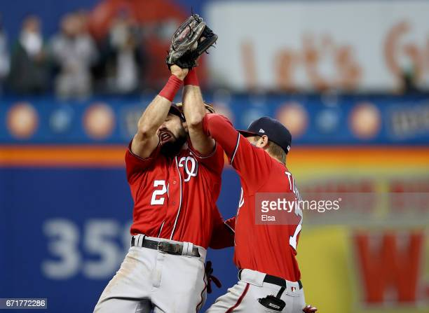 Adam Eaton and Trea Turner of the Washington Nationals collide as Eaton makes the catch on a hit by Juan Lagares of the New York Mets for the out in...