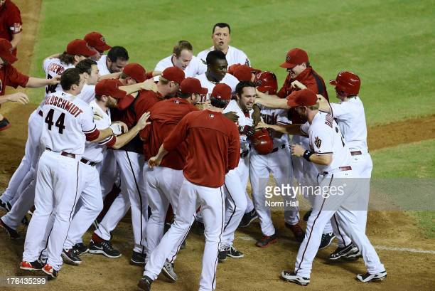 Adam Eaton of the Arizona Diamondbacks and teammates celebrate a gamewinning walkoff home run against the Baltimore Orioles at Chase Field on August...