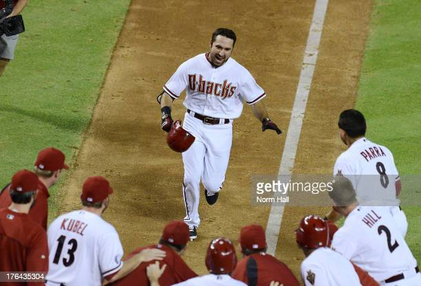 Adam Eaton of the Arizona Diamondbacks and teammates celebrate his gamewinning walkoff home run against the Baltimore Orioles at Chase Field on...