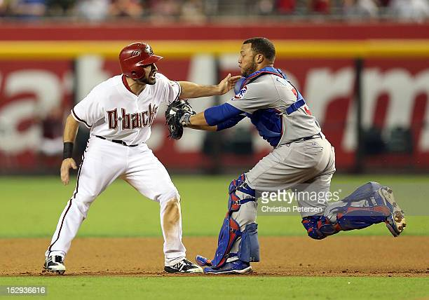 Adam Eaton of the Arizona Diamondbacks is taged out by catcher Welington Castillo of the Chicago Cubs in a run down during the seventh inning of the...
