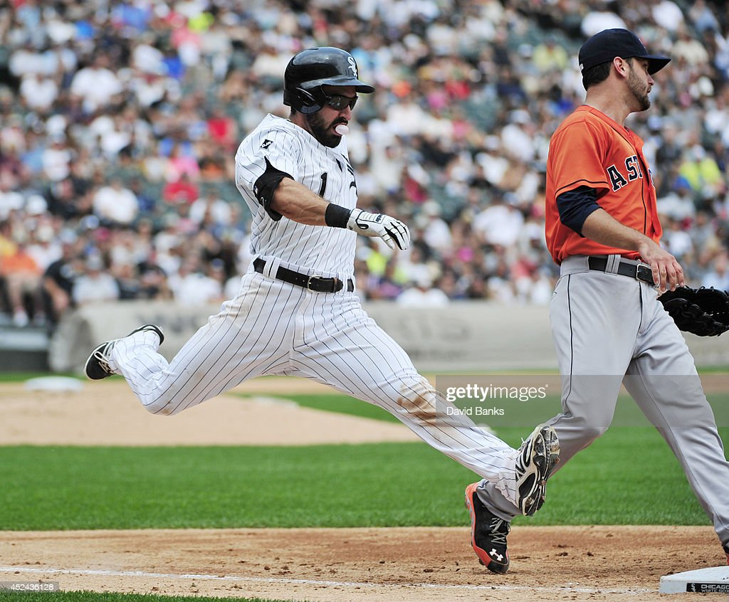Adam Eaton #1 of the Chicago White Sox beats out an infield single as Jarred Cosart #48 of the Houston Astros covers first base during the third inning on July 20, 2014 at U.S. Cellular Field in Chicago, Illinois.