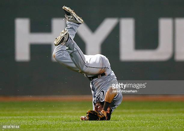 Adam Eaton of the Chicago White Sox fails to come up with the catch in center field against the Boston Red Sox during the game at Fenway Park on July...