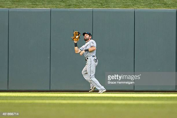 Adam Eaton of the Chicago White Sox fields against the Minnesota Twins on June 20 2014 at Target Field in Minneapolis Minnesota The Twins defeated...