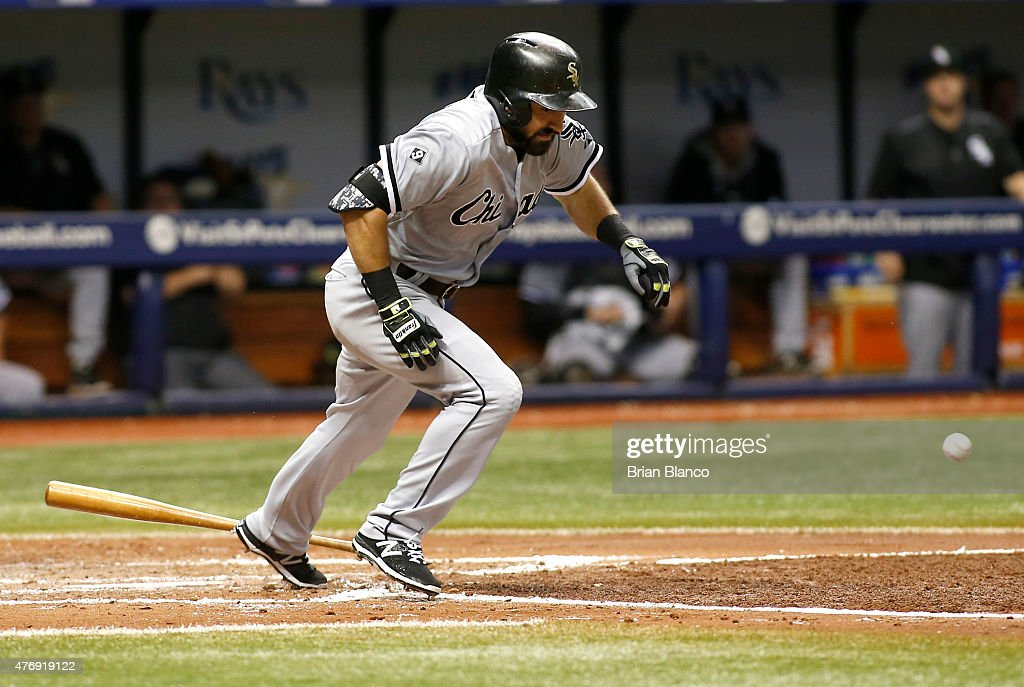 Adam Eaton #1 of the Chicago White Sox hits a bunt single to catcher Rene Rivera #44 of the Tampa Bay Rays to allow Carlos Sanchez #5 to score off the throwing error by Sanchez during the fifth inning of a game on June 12, 2015 at Tropicana Field in St. Petersburg, Florida.