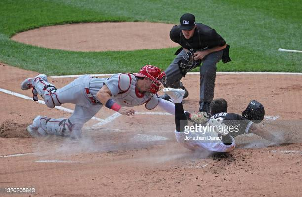 Adam Eaton of the Chicago White Sox is tagged out at the plate by Andrew Knizner of the St. Louis Cardinals in the 1st inning at Guaranteed Rate...