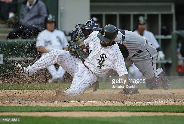 Adam Eaton of the Chicago White Sox is tagged out at the plate by Kurt Suzuki of the Minnesota Twins for the final out of the game during the White...