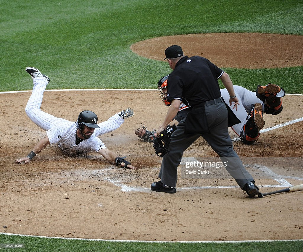 Adam Eaton #1 of the Chicago White Sox is tagged out by Buster Posey #28 of the San Francisco Giants during the third inning on June 18, 2014 at U.S. Cellular Field in Chicago, Illinois.