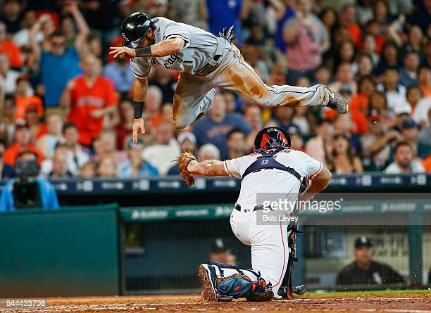 Adam Eaton of the Chicago White Sox is tagged out by Evan Gattis of the Houston Astros as he attempts to leap over him in the third inning at Minute...