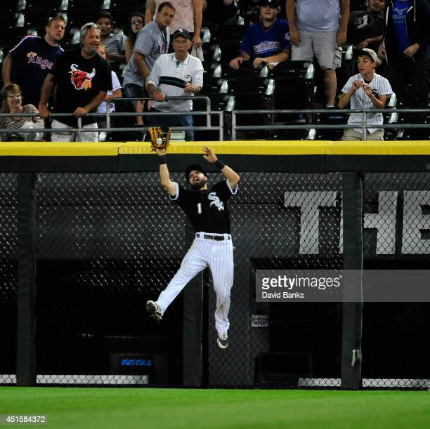Adam Eaton of the Chicago White Sox makes a catch on Kole Calhoun of the Los Angeles Angels of Anaheim in the eighth inning during the second game of...