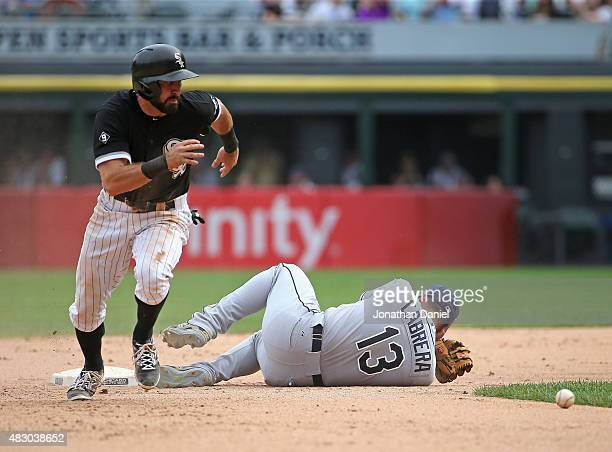 Adam Eaton of the Chicago White Sox moves to third base in the 10th inning after Asdrubal Cabrera of the Tampa Bay Rays is hit in the head with the...