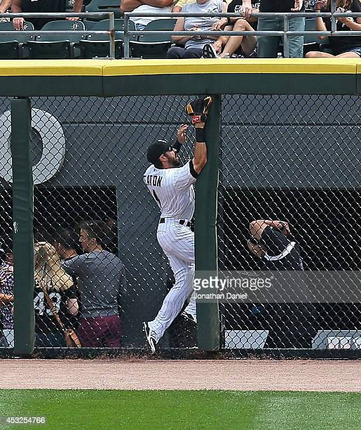 Adam Eaton of the Chicago White Sox runs into the fence trying to make a catch of a home run ball hit by Adam Rosales of the Texas Rangers in the 2nd...