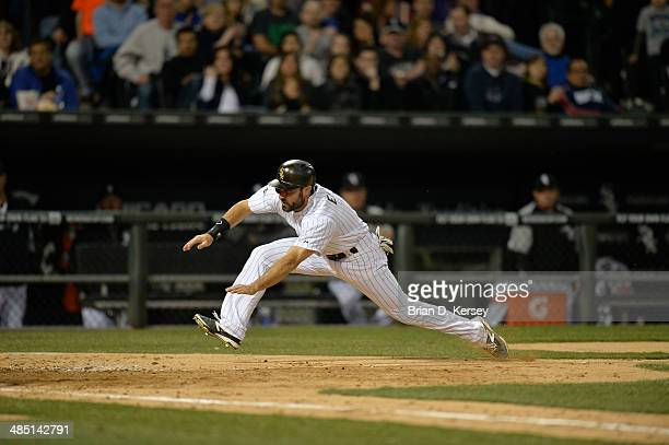 Adam Eaton of the Chicago White Sox scores during the fifth inning against the Cleveland Indians at US Cellular Field on April 11 2014 in Chicago...