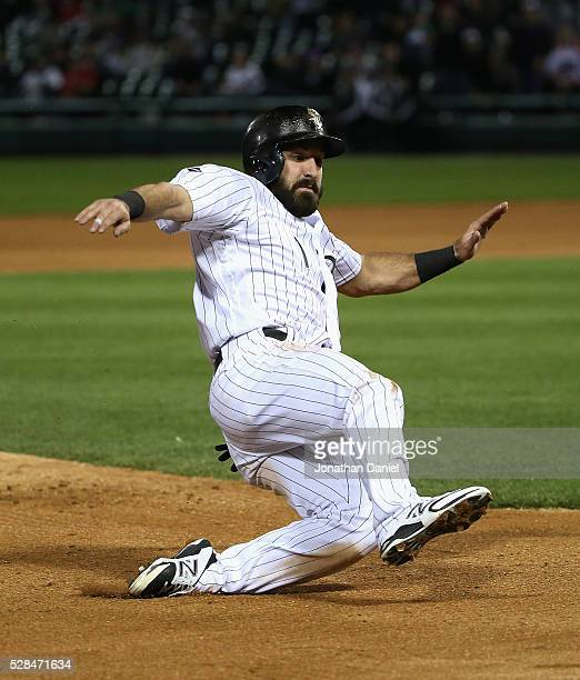Adam Eaton of the Chicago White Sox slides into third base on a wild pitch in the 8th inning against the Boston Red Sox at US Cellular Field on May 3...