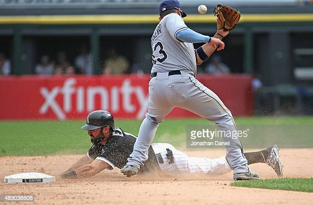 Adam Eaton of the Chicago White Sox steals second base in the 10th inning as Asdrubal Cabrera of the Tampa Bay Rays is hit in the head with the ball...