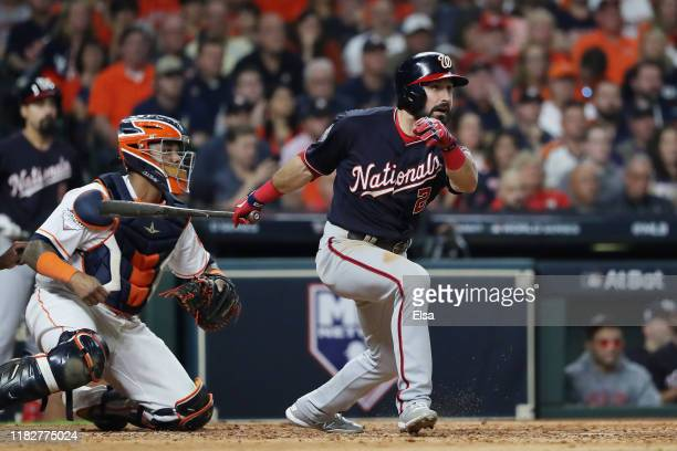 Adam Eaton of the Washington Nationals hits an RBI single against the Houston Astros during the fifth inning in Game One of the 2019 World Series at...