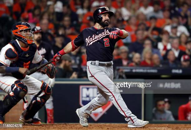 Adam Eaton of the Washington Nationals hits his two-run home run against the Houston Astros during the eighth inning in Game Two of the 2019 World...
