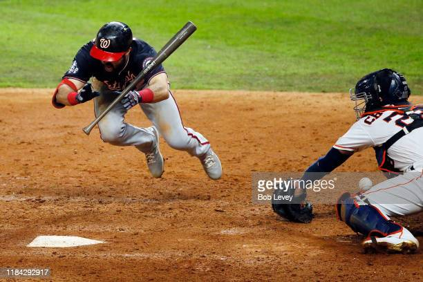 Adam Eaton of the Washington Nationals is hit by the pitch against the Houston Astros during the ninth inning in Game Six of the 2019 World Series at...