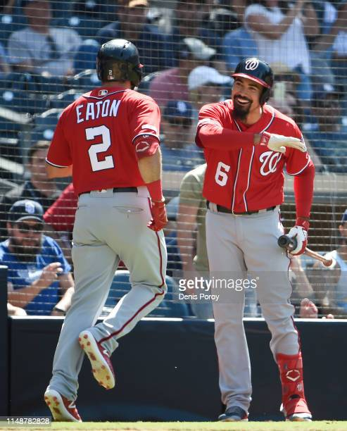 Adam Eaton of the Washington Nationals, left,, is congratulated by Anthony Rendon after hitting a solo home run during the eighth inning of a...