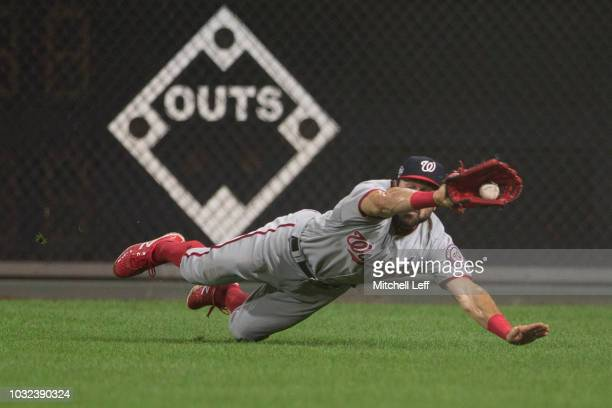 Adam Eaton of the Washington Nationals makes a diving catch on a ball it by Odubel Herrera of the Philadelphia Phillies in the bottom of the seventh...