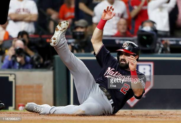Adam Eaton of the Washington Nationals scores a run on a double by Anthony Rendon against the Houston Astros during the first inning in Game Two of...