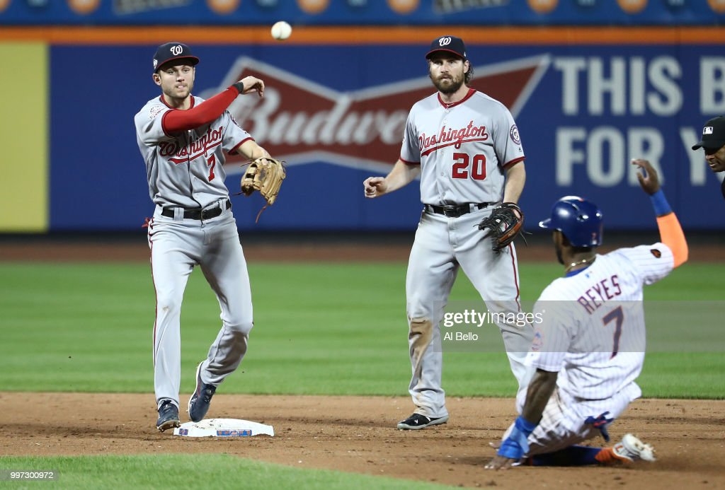 Adam Eaton #2 of the Washington Nationals turns a double play against Jose Reyes #7 of the New York Mets to end the game and preserve a 5-4 win during their game at Citi Field on July 12, 2018 in New York City.