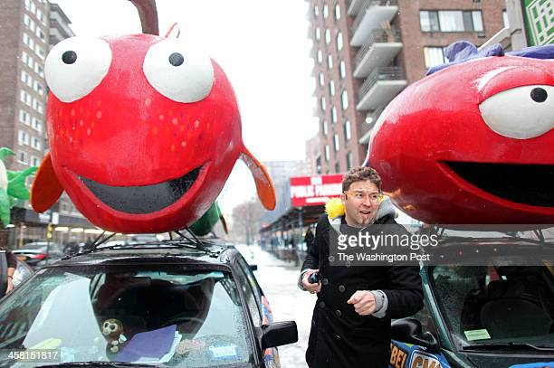 Adam Eidinger a GMO food labeling activist and organizer of areweeatingfishyfoodcom by the company's fruit and fishadorned cars near Whole Foods on...