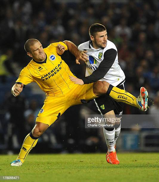 Adam ElAbd of Brighton tries to block off the run of Gary Hooper of Norwich City during the pre season friendly match between Brighton Hove Albion...