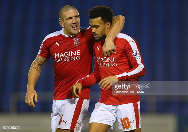 Adam ElAbd of Swindon Town congratulates Nicky Ajose of Swindon Town during the Sky Bet League One match between Shrewsbury Town and Swindon Town at...