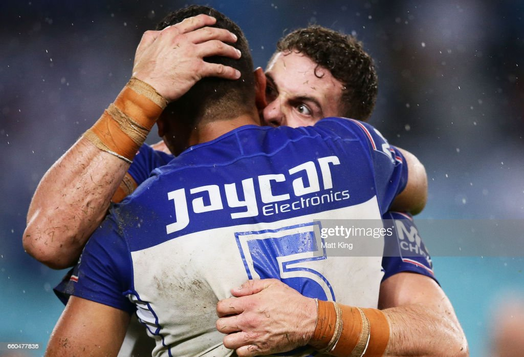 Adam Elliot of the Bulldogs (R) celebrates with Marcelo Montoya of the Bulldogs (L) at fulltime during the round five NRL match between the Canterbury Bulldogs and the Brisbane Broncos at ANZ Stadium on March 30, 2017 in Sydney, Australia.