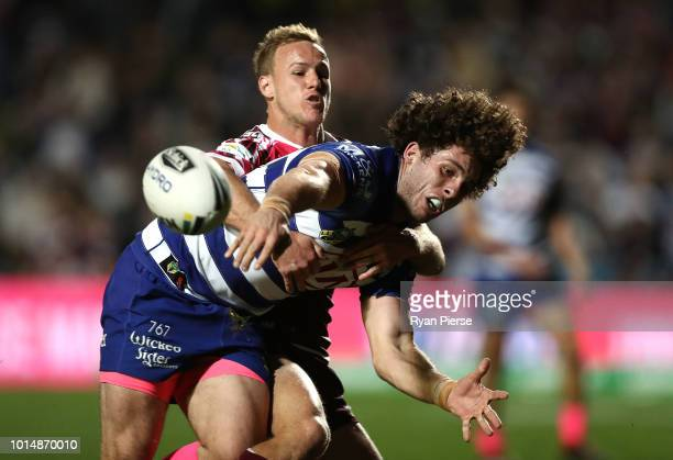 Adam Elliot of the Bulldogs is tackled by Dale CherryEvans of the Sea Eagles during the round 22 NRL match between the Manly Sea Eagles and the...