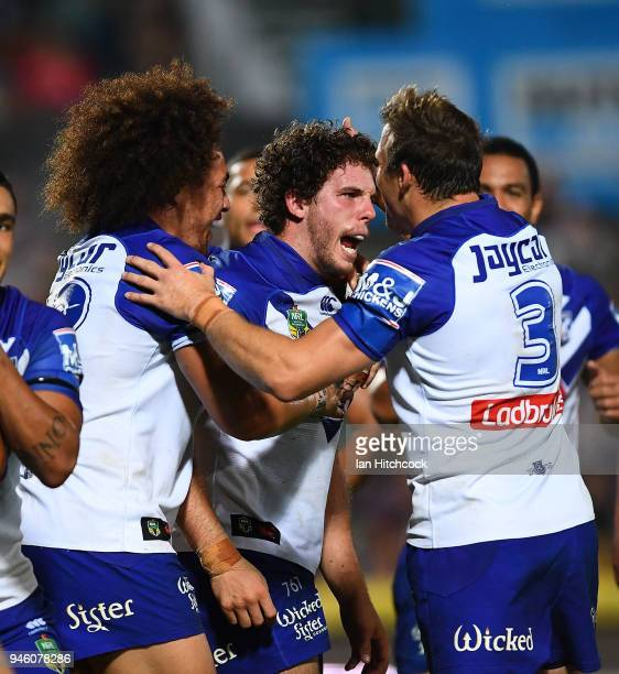 Adam Elliott of the Bulldogs celebrates after scoring a try during the round six NRL match between the North Queensland Cowboys and the Canterbury...
