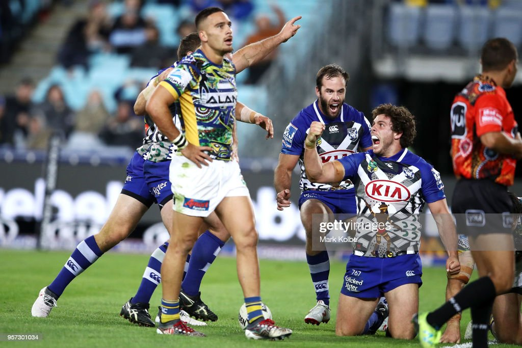 Adam Elliott of the Bulldogs celebrates scoring a try during the round 10 NRL match between the Canterbury Bulldogs and the Parramatta Eels at ANZ Stadium on May 11, 2018 in Sydney, Australia.