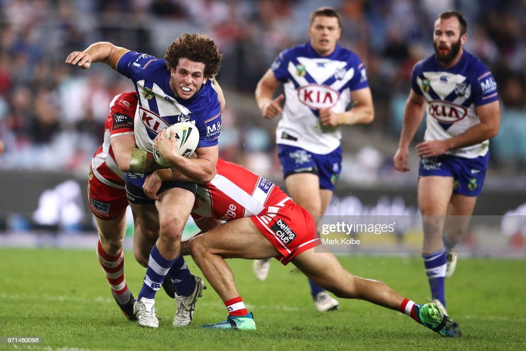 Adam Elliott of the Bulldogs is tackled during the round 14 NRL match between the Canterbury Bulldogs and the St George Illawarra Dragons at ANZ Stadium on June 11, 2018 in Sydney, Australia.