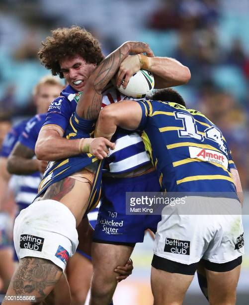 Tepai Moeroa of the Eels runs with the ball during the round 19 NRL match between the Parramatta Eels and the Canterbury Bulldogs at ANZ Stadium on...