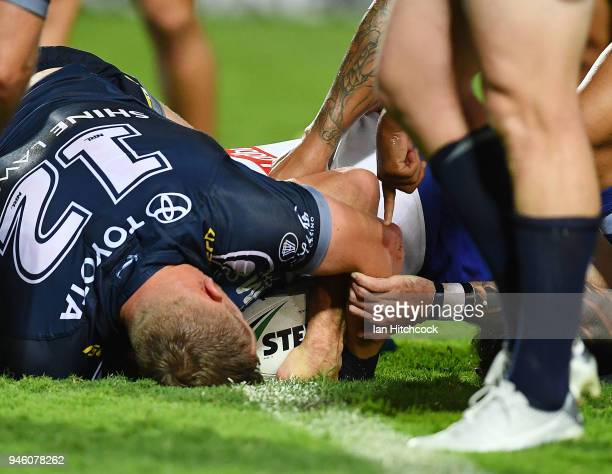 Adam Elliott of the Bulldogs scores a try during the round six NRL match between the North Queensland Cowboys and the Canterbury Bulldogs at...