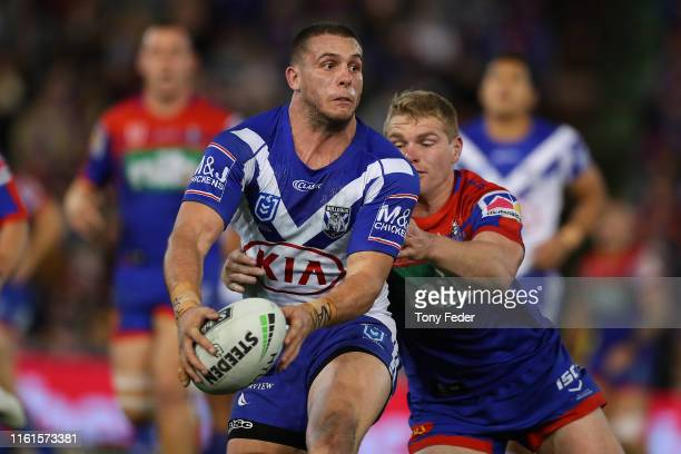 Adam Elliott of the Canterbury Bulldogs is tackled during the round 17 NRL match between the Newcastle Knights and the Canterbury Bulldogs at...